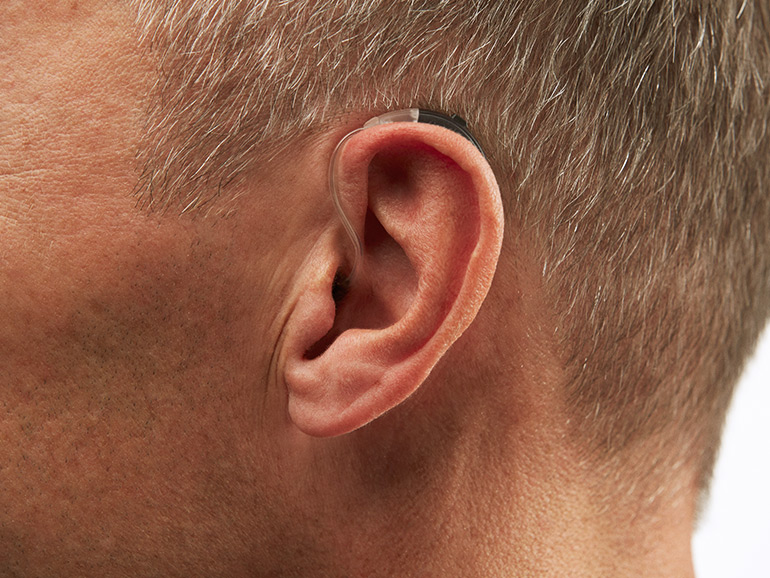 Micro behind the ear hearing aid device